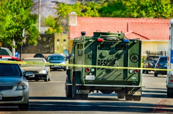SWAT vehicles leave the scene.